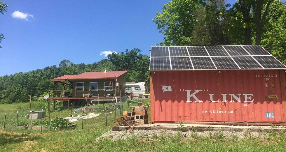 You can see the off-grid solar panels in the foreground where Morgan built in Ohio, one of the best places to live off the grid
