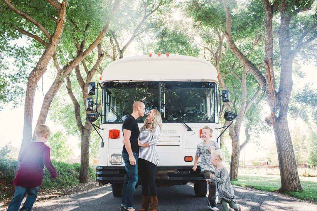 Man runs business while living in custom school bus with his family