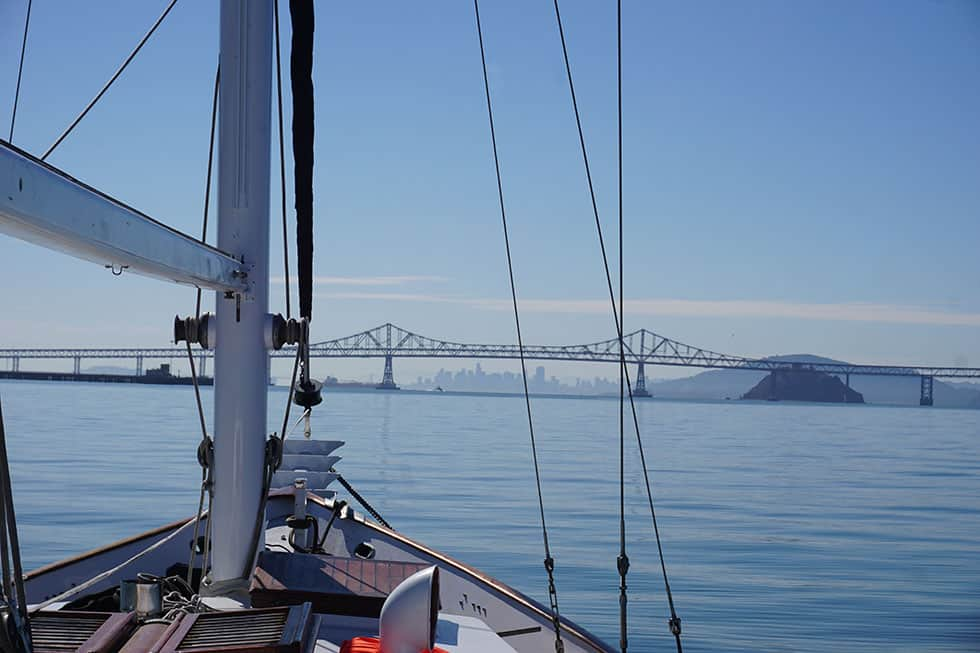 Our liveaboard sailboat heads to the Richmond Bridge in the San Francisco Bay