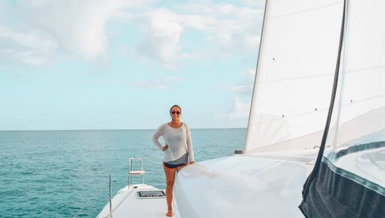Michelle Schroeder-Gardner standing on the bow of her catamaran
