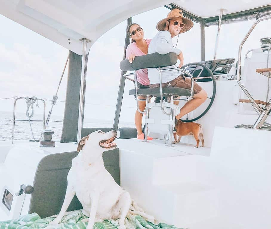 Michelle and her husband aboard their catamaran sailboat
