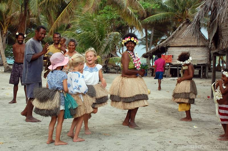 The kids dance with island natives during their adventures bluewater sailing around the world
