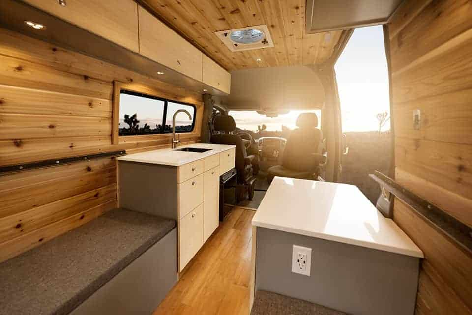 Gorgeous sprinter van conversion built out with wood interior and ceiling. Learn how to build an awesome camper van conversion