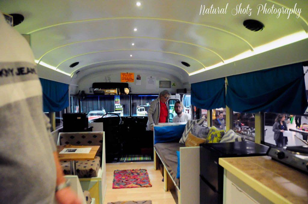Living in a school bus conversion can be hard. Patrick looks out over the inside of his new skoolie RV