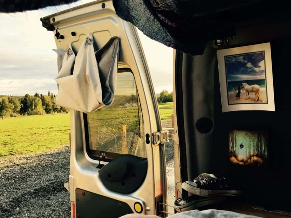 Sarah is very happy living in her Ford Transit camper van. The view out the back doors is beautiful