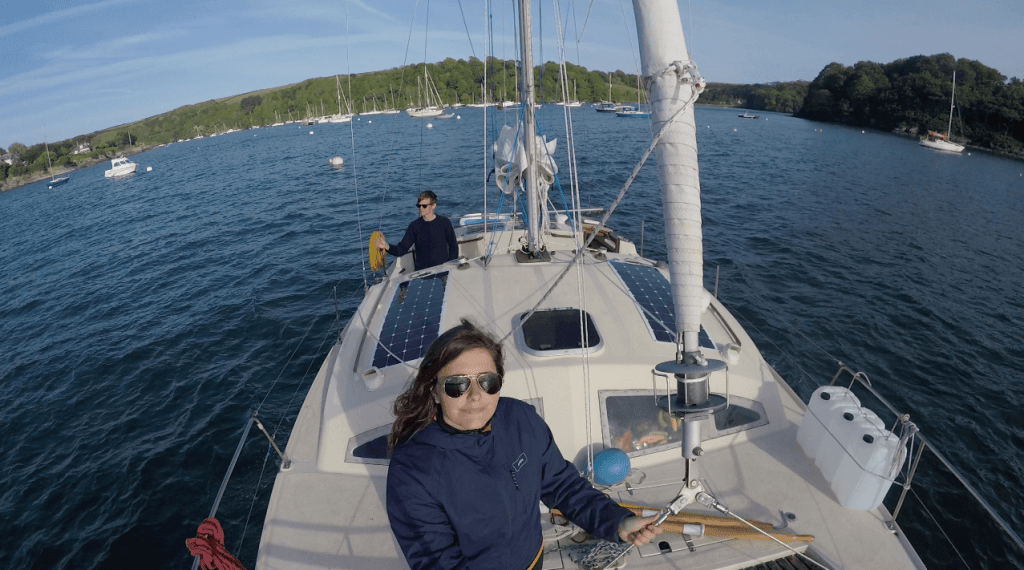 Ryan and Elena are seen on deck of their catamaran boat
