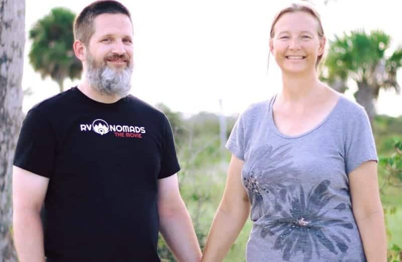 Couple holding hands. They paid off $91,00 in debt while living in an RV