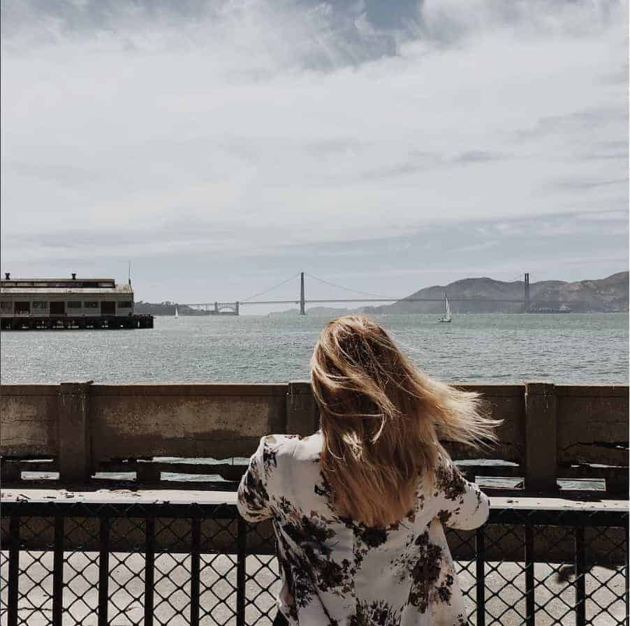 J learned how to pay off debt fast with an awesome debt management plan. Here she is looking out over the Golden Gate Bridge in San Francisco.