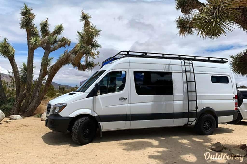 Mercedes Sprinter campervan parked in Joshua Tree