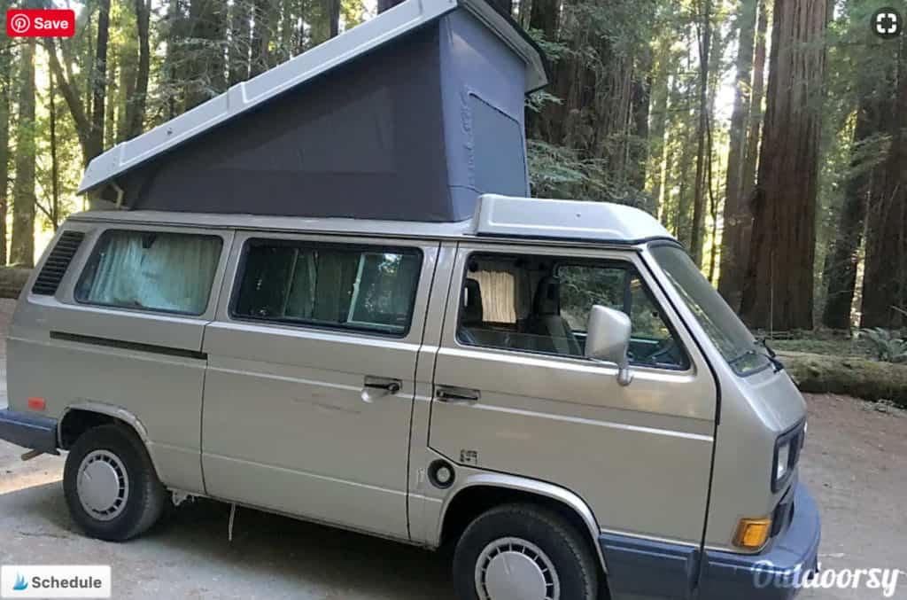 Volkswagen Westfalia camper van rental with the pop top raised