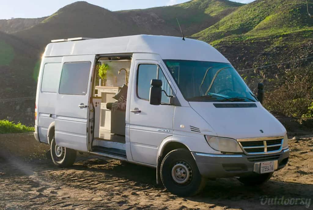 White Dodge Sprinter campervan with side door open
