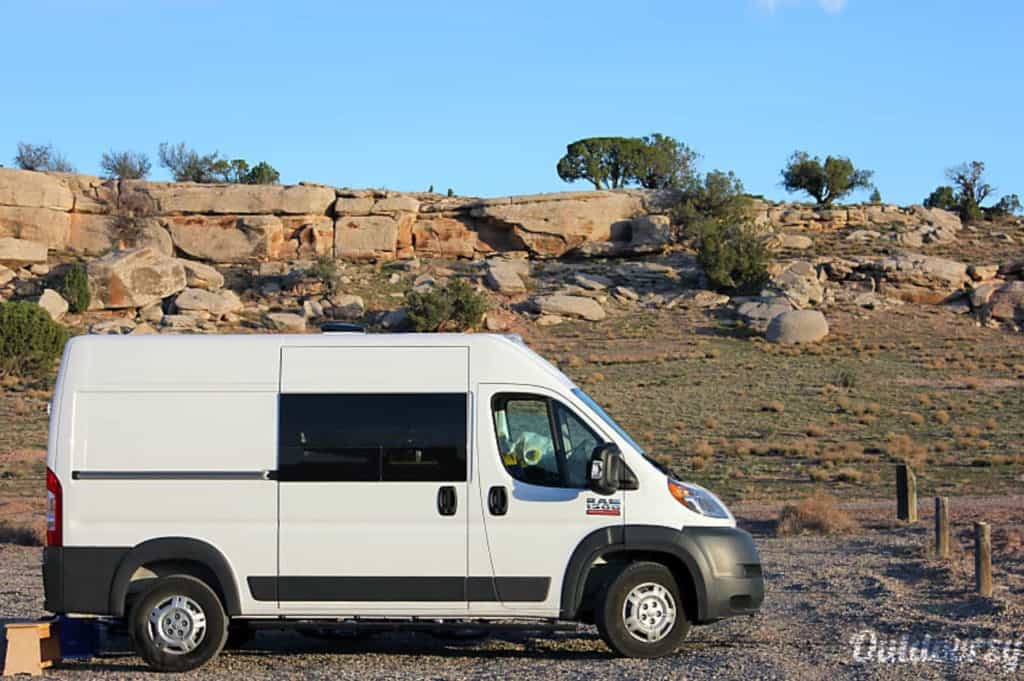 Dodge Promaster camper parked near rocks