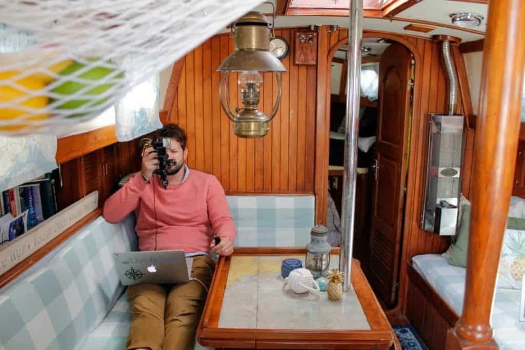 Garrett sits in the living room area of his liveaboard sailboat