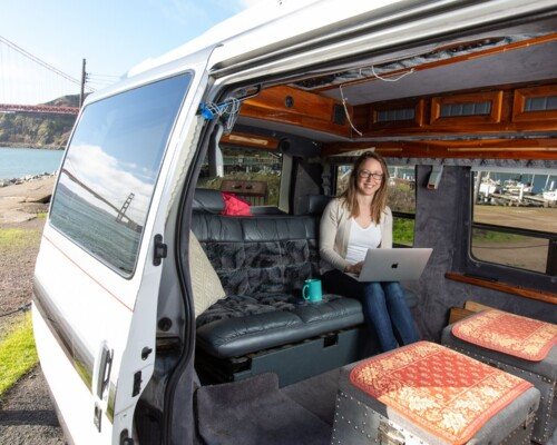Kristin doing a van life job from her Chevy Astro Van