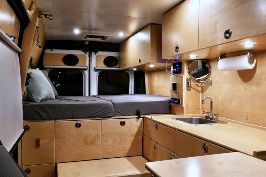 The Dodge van has a sideways Murphy Bed in it and just as much room as a Mercees Sprinter camper van