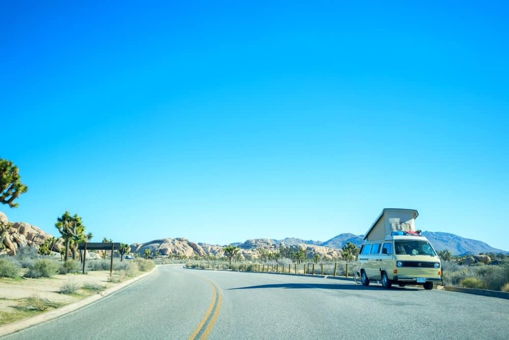 VW bus parked on the side of the road near Joshua Tree
