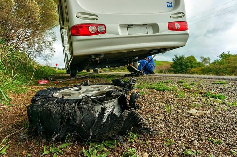 RV on the side of the road with a blown out tire - how to pick the best roadside assistance to help