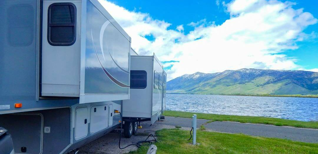 The Foley's RV parked near a beautiful body of water, where it can be hard to get WiFi to run an Amazon FBA Business