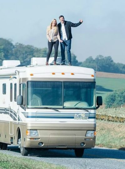 Emily and Hudson are Vipkid Teachers standing on top of their RV