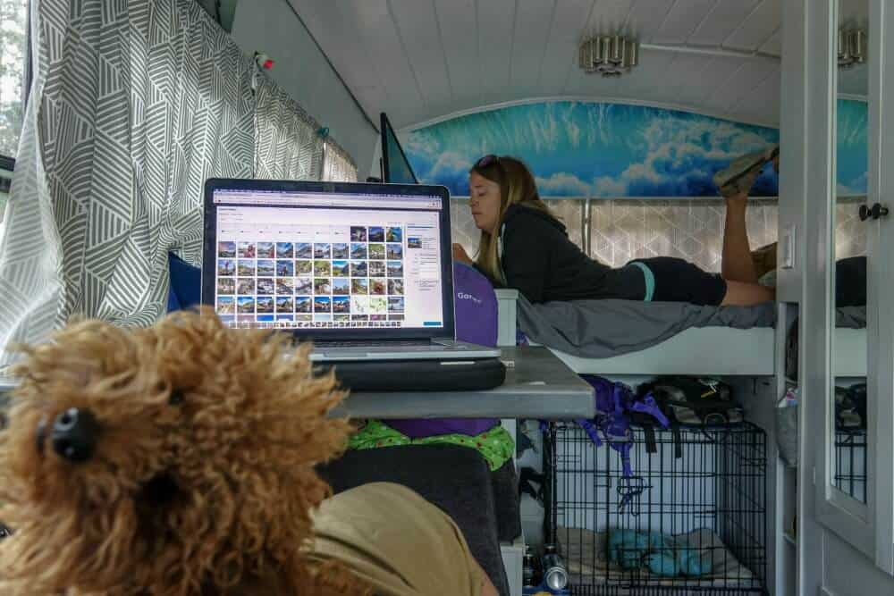 The couple converted this custom school bus camper to have a work area, a couch and a bedroom