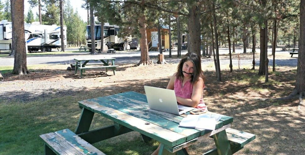 Camille works outside at a campground while RVing full time