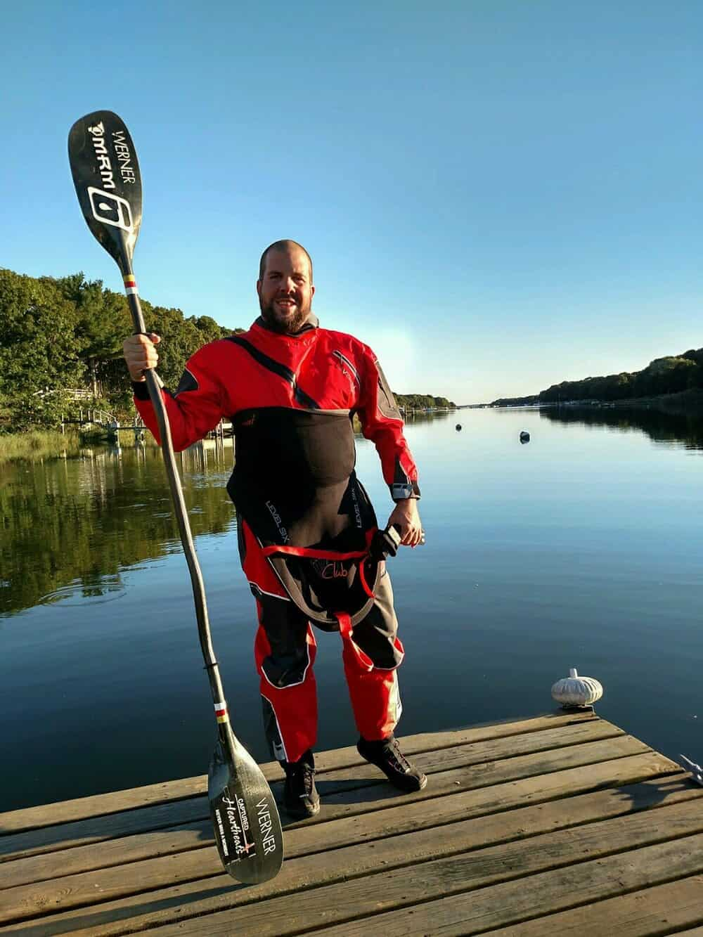 Kayaker Rich Brand poses with his kayak paddle