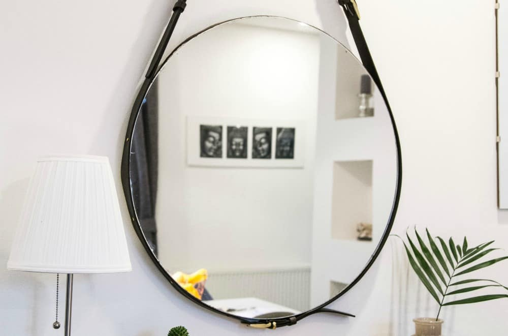 Hanging mirrors are a great design hack to make a tiny house look bigger