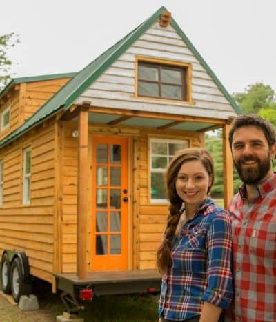 Alexis and her husband in front of their tiny house. Finding the best gifts for tiny house owners can be tough!