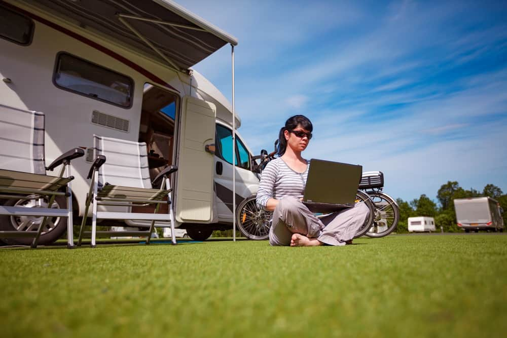 Woman with a remote work job outside her RV
