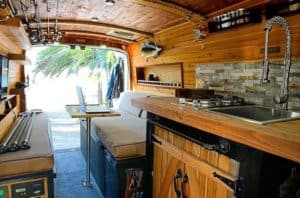 This simple campervan kitchen has an awesome pull down faucet