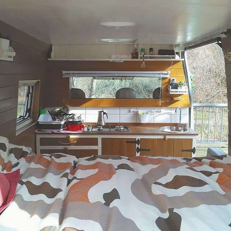 This small campervan kitchen cozies up to the two front seats