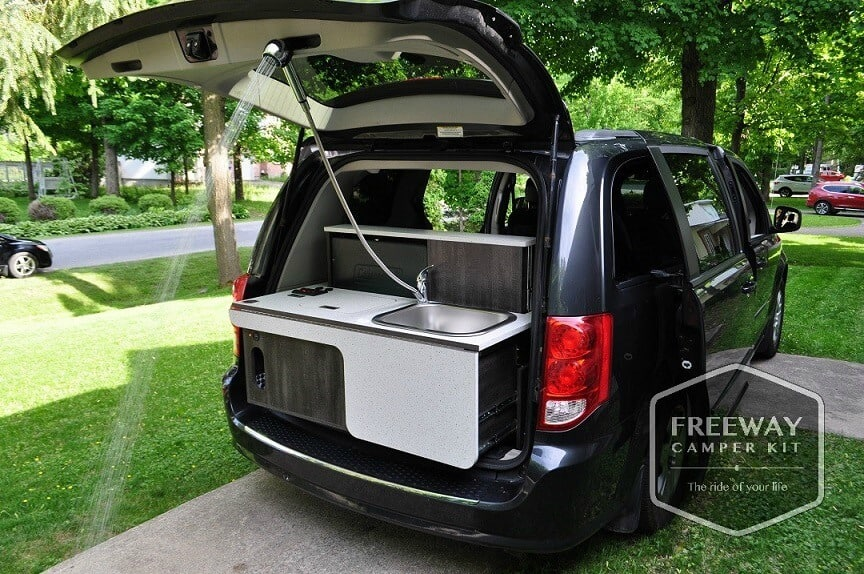 The back hatch of a vehicle raised to show the Freeway Campervan conversion kit