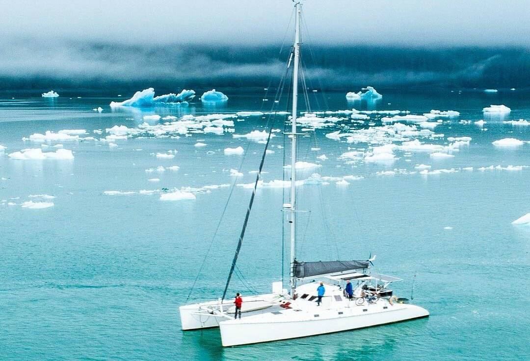 Catamaran sailboat shown in Alaska near icebergs