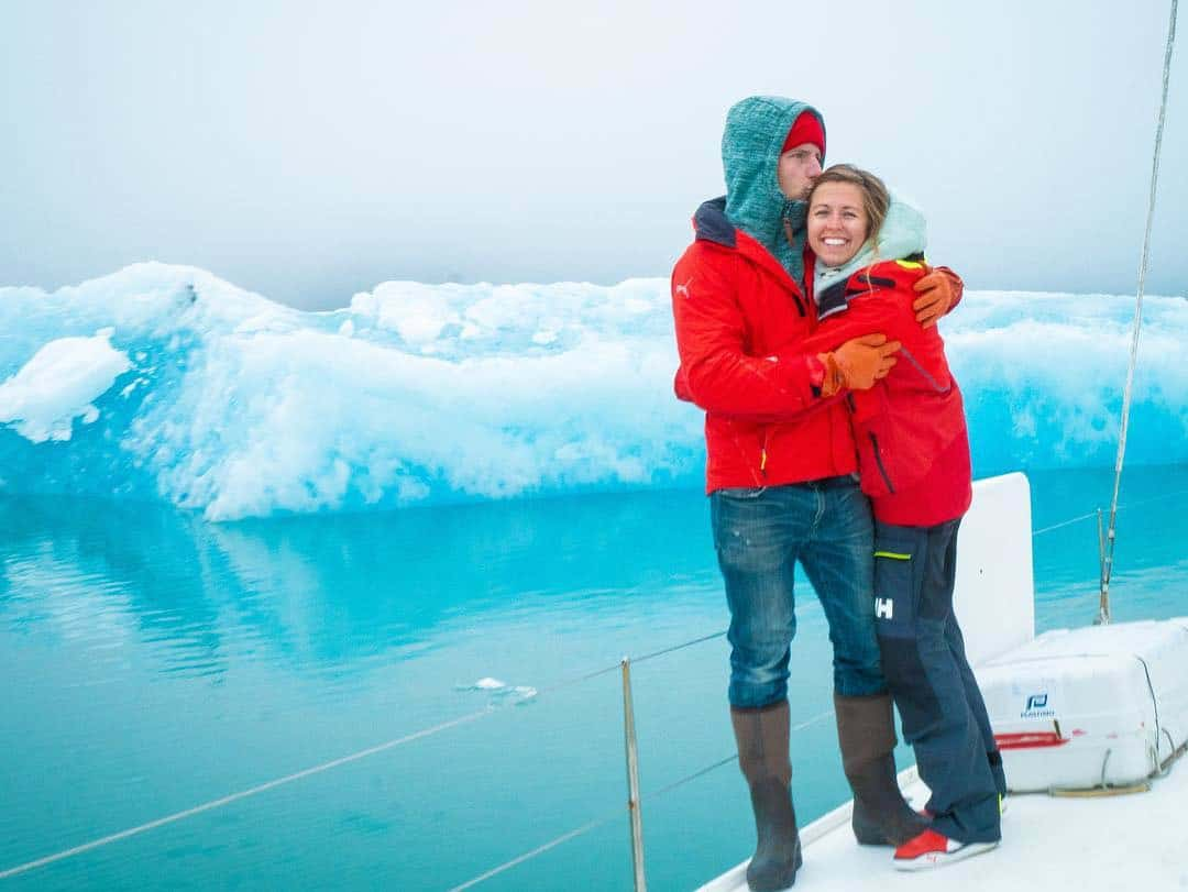 Couple aboard their 55' cruising catamaran in Alaska