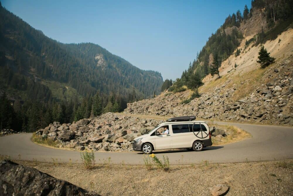 Mercedes Metris Camper Van driving on a scenic highway
