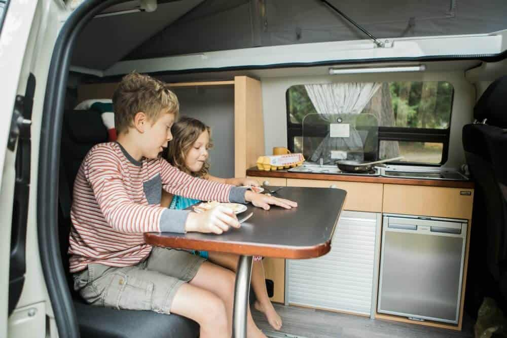Mercedes Metris Full Camper Van with kids sitting inside