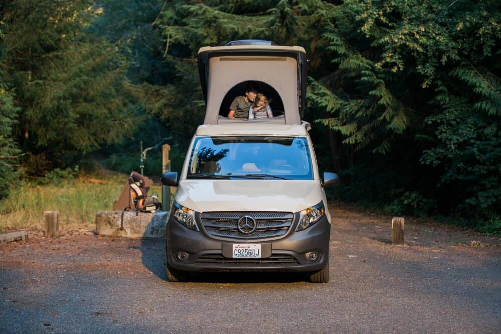Mercedes Metris Pop-Top camper shown in a campsite