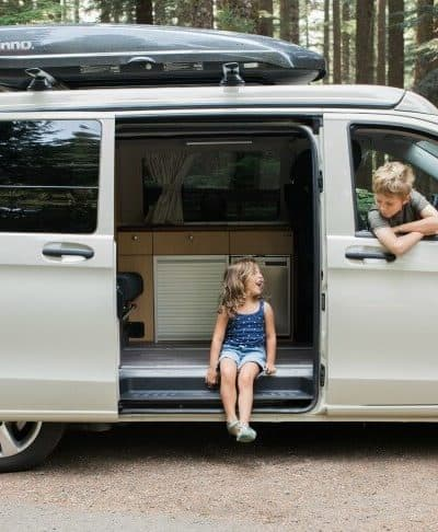 Peace Vans Pop-Up Camper with kids sitting in the van