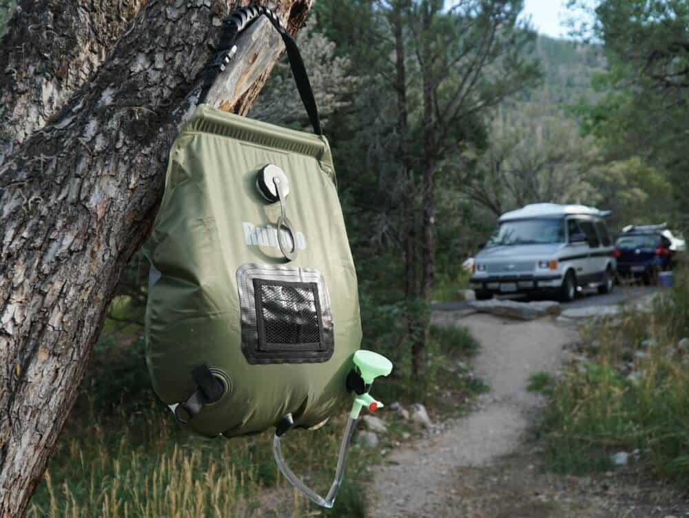 Solar Shower hanging in a tree if you can't find a public shower for van life
