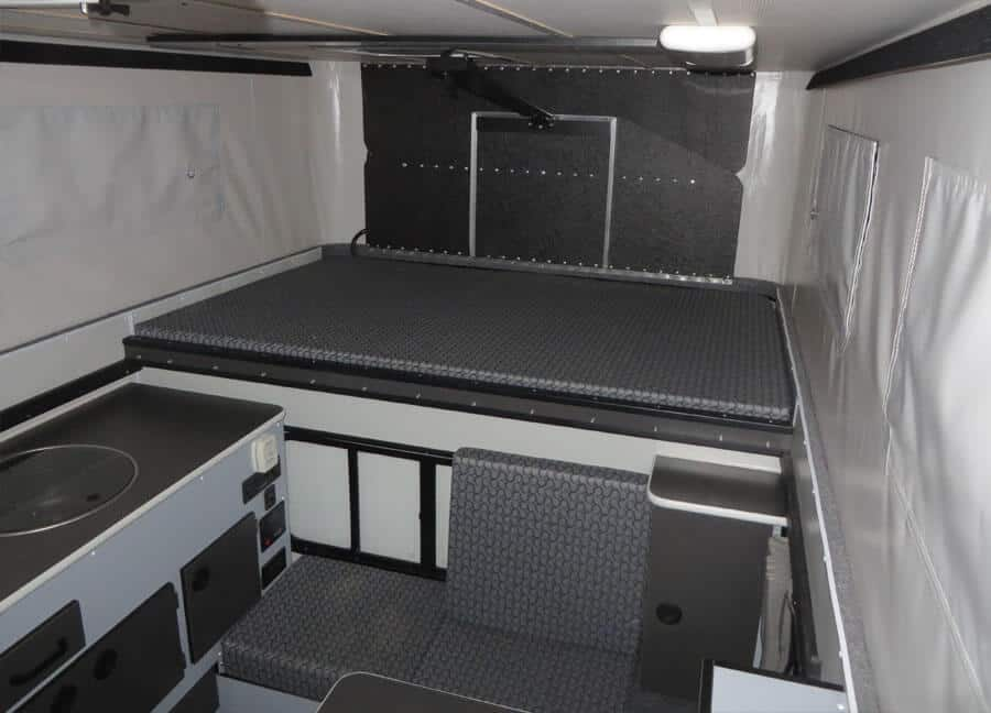 Bed area of the Fleet Truck Camper by Four Wheel Campers