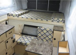 Bed area of the Grandby Truck Camper by Four Wheel Campers