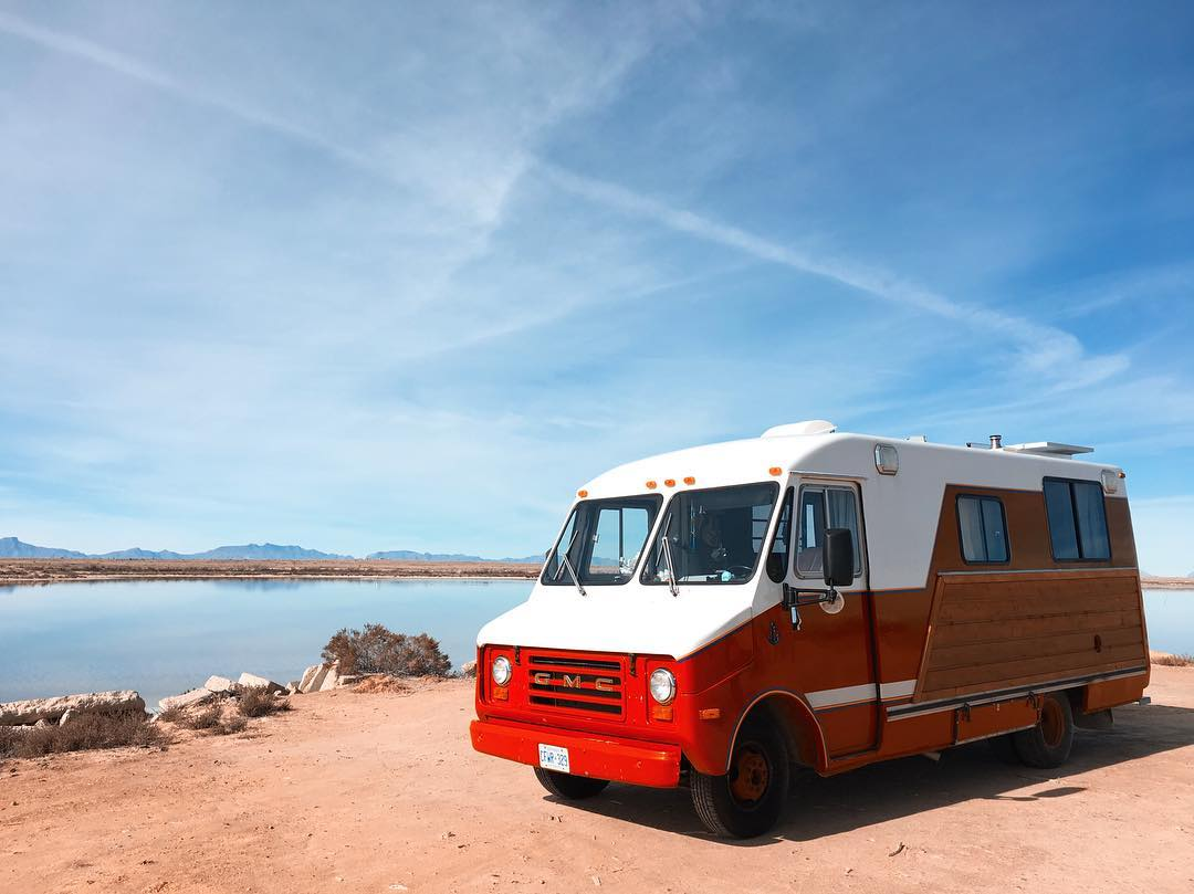 The bright red stepvan parked near water