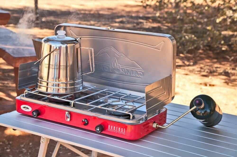 Camp Chef Everest on a camping table with a coffee percolater