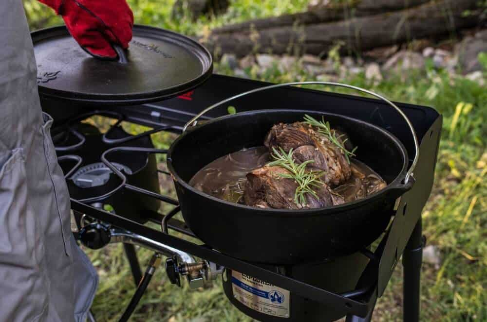 Camp Chef Explorer Freestanding Stove with a cast iron post cooking meant
