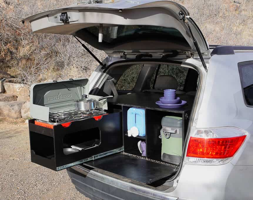 The SUV car camper conversion kit is storage space and a pull-out kitchen