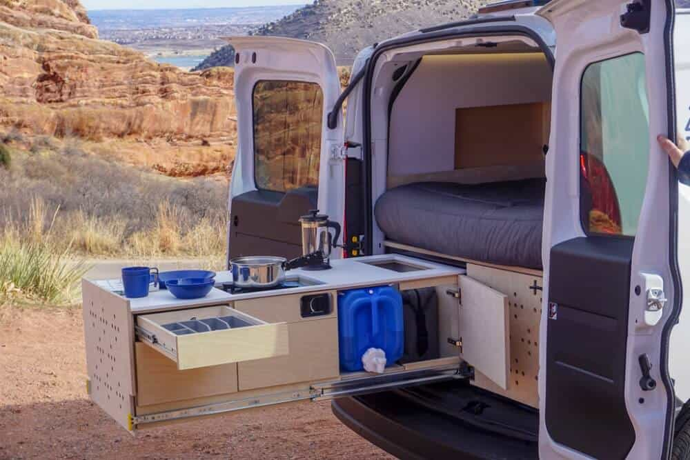 The Cargo Van Conversion car camper kit comes with two slide-out drawers to create an outdoor kitchen.