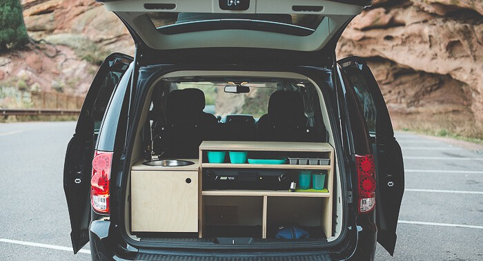 Just pop the hatch on your minivan camper conversion kit to access the kitchen and storage