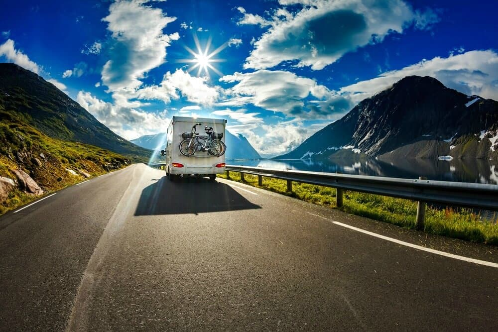 RV Motorhome driving down a scenic highway