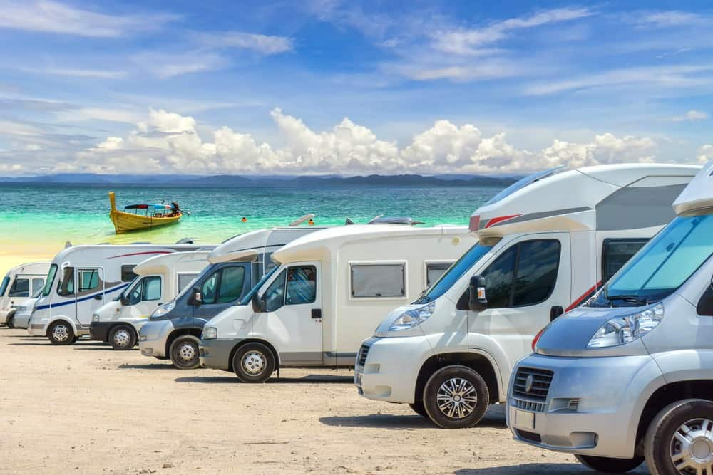 RVs lined up by a beautiful beach