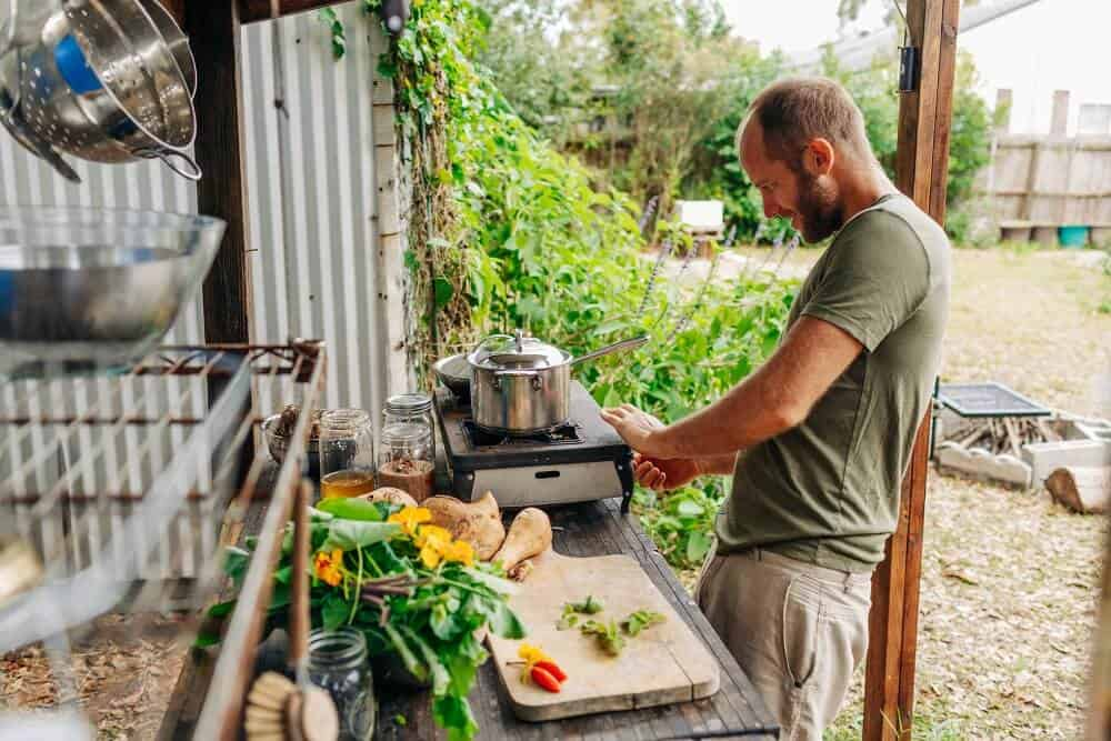 Rob Greenfield cooks in his outdoor kitchen